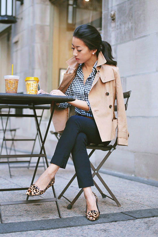 30 Chic Work Outfits to Wear this Summer: Fashion blogger 'Extra Petite' wearing a beige trench coat, a navy gingham shirt, navy ankle pants and leopard flats. Work outfits, summer work outfits, office wear, business casual, fashion, street style, womens fashion, trench coat outfit, spring work outfit.