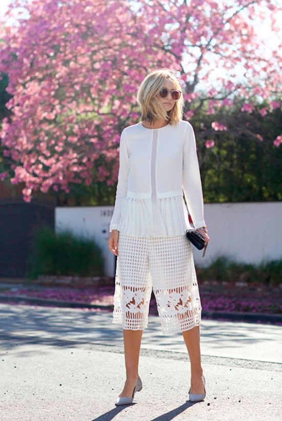 30 Chic Work Outfits to Wear this Summer: Fashion blogger 'Late Afternoon' wearing a white peplum blouse, white lace crop wide leg pants, grey block heel pumps and cat eye sunglasses. Work outfits, summer work outfits, office wear, business casual, fashion, street style, womens fashion.