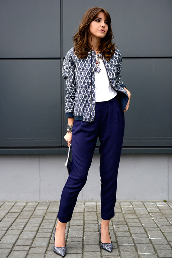 30 Chic Work Outfits to Wear this Summer: Fashion blogger 'Lovely Pepa' wearing a navy bomber jacket, a white t-shirt, blue ankle pants and glitter heels. Work outfits, summer work outfits, office wear, business casual, fashion, street style, womens fashion.