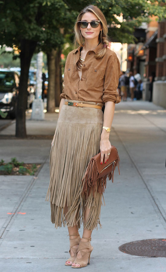 30 Chic Work Outfits to Wear this Summer: Fashion blogger 'Olivia Palermo' wearing a brown suede shirt, a brown fringe suede midi skirt, beige suede cutout sandals, black sunglasses, a brown belt and a brown fringe clutch. Work outfits, summer work outfits, office wear, business casual, fashion, street style, womens fashion.