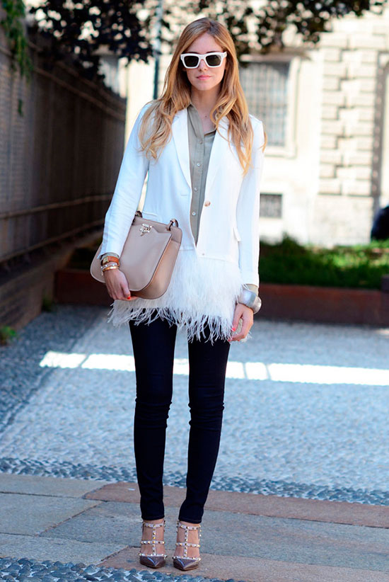 30 Chic Work Outfits to Wear this Summer: Fashion blogger 'The Blonde Salad' wearing a white feather hem blazer, a beige shirt, black skinny jeans, brown studded heels, white sunglasses and a beige shoulder bag. Work outfits, summer work outfits, office wear, business casual, fashion, street style, womens fashion, spring work outfits.