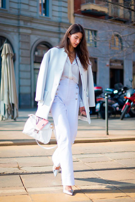 30 Chic Work Outfits to Wear this Summer: Woman wearing a white peacoat, a white blouse, white sailor pants, white heels and a white handbag. Work outfits, summer work outfits, office wear, business casual, fashion, street style, womens fashion, all white outfit.