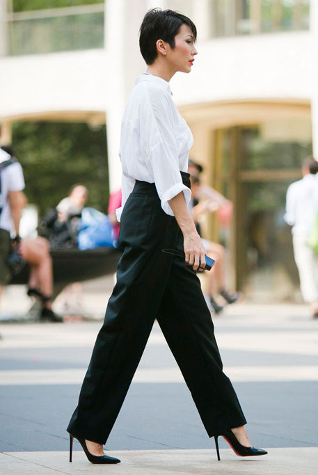 30 Chic Work Outfits to Wear this Summer: Woman wearing a white shirt, black high waist trousers and black patent heels. Work outfits, summer work outfits, office wear, business casual, fashion, street style, womens fashion, spring work outfits.