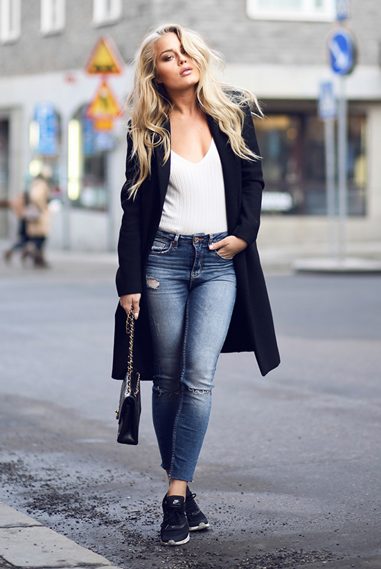 Street Style - The Top Blogger Looks Of The Week: Fashion Blogger 'Angelica Blick' wearing a black long blazer, a white v-neck t-shirt, skinny jeans, black sports sneakers and a black quilted shoulder bag