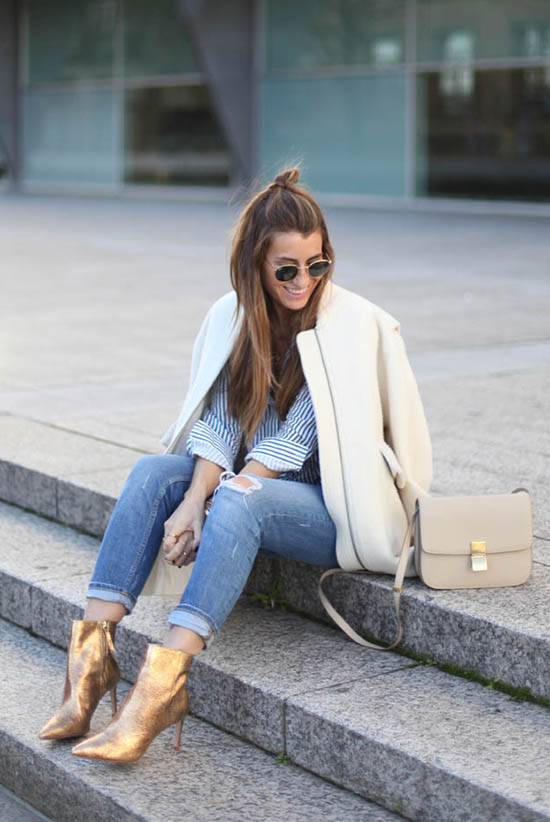 Street Style - The Top Blogger Looks Of The Week: Fashion Blogger 'Bartabac' wearing a white collarless jacket, a light blue and white stripe shirt, distressed skinny jeans, golden pointy toe heeled booties, brown round sunglasses and a white shoulder bag