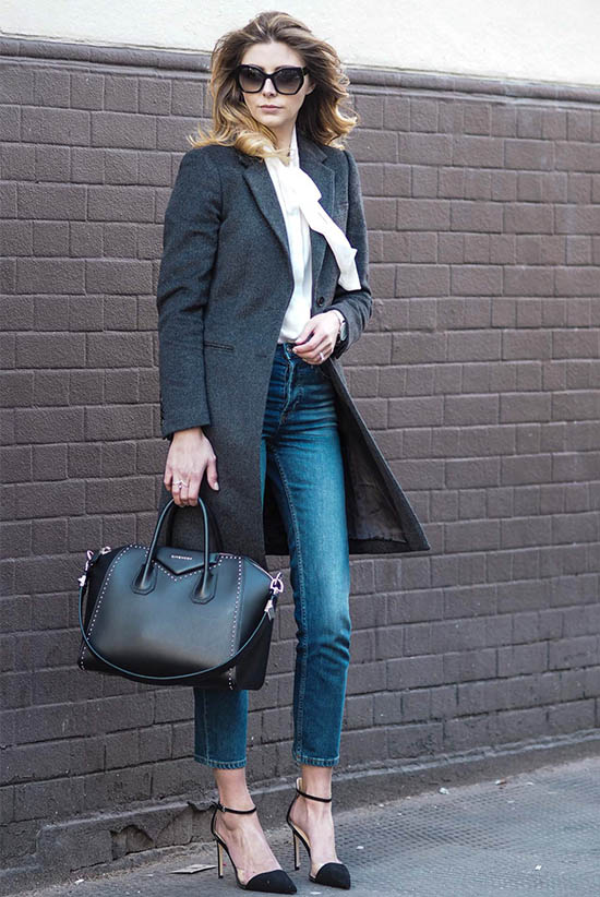 Street Style - The Top Blogger Looks Of The Week: Fashion Blogger 'EJ Style' wearing a grey long coat, a white tie-neck shirt, crop jeans, black suede ankle strap pointy toe heels, black hexagonal sunglasses and a black handbag