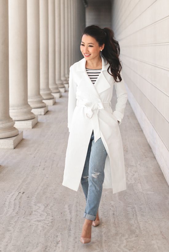 Street Style - The Top Blogger Looks Of The Week: Fashion Blogger 'Extra Petite' wearing a white trench coat, a black and white stripe long sleeve t-shirt, boyfriend jeans and nude pointy toe heels