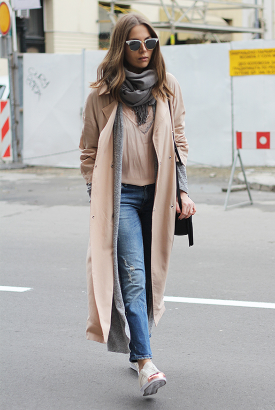 Street Style - The Top Blogger Looks Of The Week: Fashion Blogger 'Fashion And Style' wearing a grey scarf, a blush trench coat, a grey long cardigan, a blush t-shirt, skinny jeans, white and copper cap-toe sneakers, black and white clubmaster sunglasses and a black shoulder bag