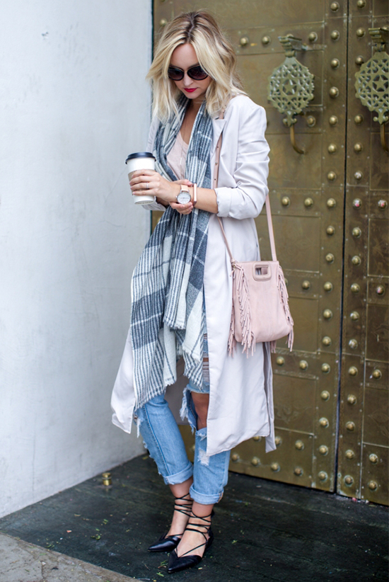 Street Style - The Top Blogger Looks Of The Week: Fashion Blogger 'Late Afternoon' wearing a grey and white plaid scarf, a beige light coat, a blush t-shirt, distressed boyfriend jeans, black lace-up flats, black sunglasses and a pale pink fringe shoulder bag
