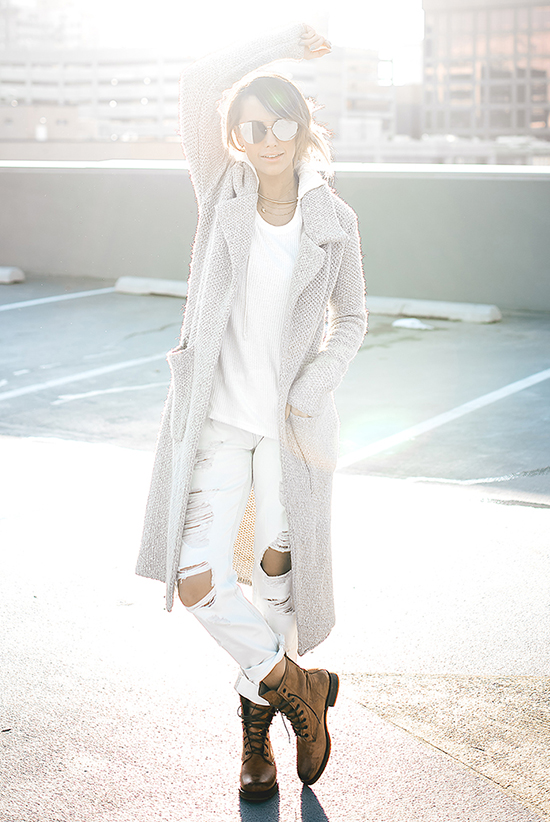 Street Style - The Top Blogger Looks Of The Week: Fashion Blogger 'Style'd Avenue' wearing a light grey coat, a white t-shirt, white distressed skinny jeans, mirror sunglasses and brown laced up mid-calf boots
