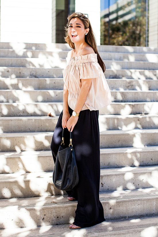 Street Style - The Top Blogger Looks Of The Week: Fashion Blogger 'The Darling Detail' wearing a blush off the shoulder top, black wide leg pants, nude sandals, navy mirror sunglasses and a black handbag
