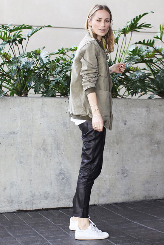 bomber jacket - The Bomber Is Fashion's Favorite Spring Jacket: Fashion blogger 'Anine's World' wearing a military green bomber jacket, a white oversized t-shirt, leather ankle pants and white sneakers. spring outfits, fall outfits, athleisure, comfy outfits, sneakers outfits