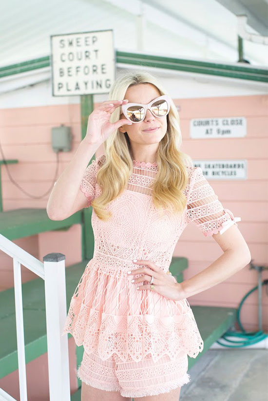 Street Style - The Top Blogger Looks Of The Week: Fashion blogger 'Atlantic Pacific' wearing a blush lace coordinate with a short sleeve peplum top and shorts, plus pink mirror cat eye sunglasses
