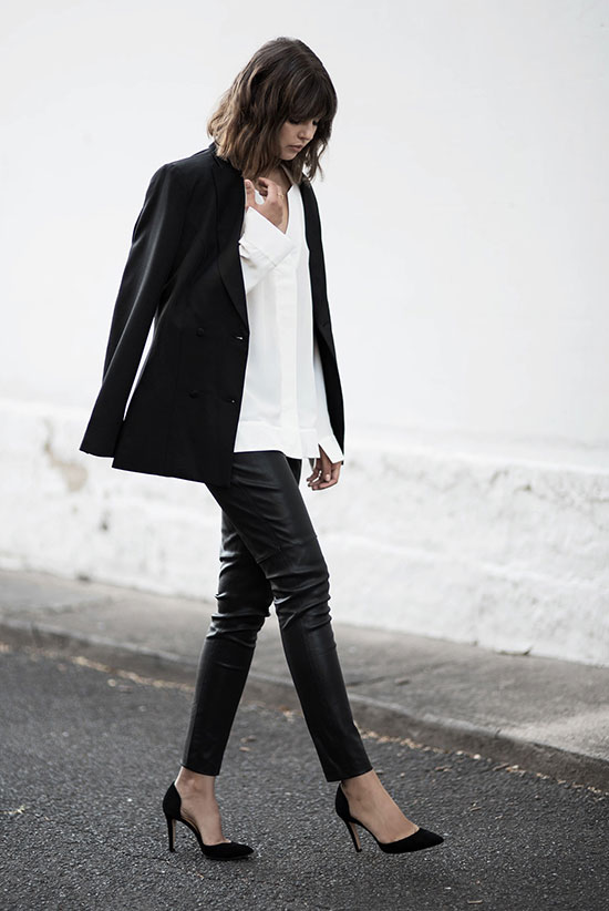spring work outfits - 30 Spring Work Outfits To Try Right Now: Fashion Blogger 'Badlands' wearing a black blazer, a white v-neck blouse, black leather ankle pants and black pointy toe heels