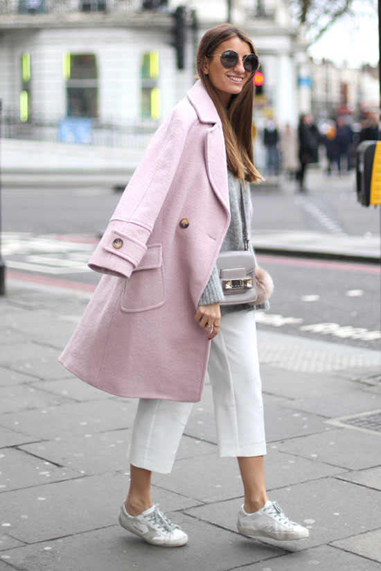 Street Style - The Top Blogger Looks Of The Week: Fashion blogger 'Bartabac' wearing a light pink long coat, a grey sweater, white crop pants, white sneakers, oversized sunglasses and a light grey shoulder bag