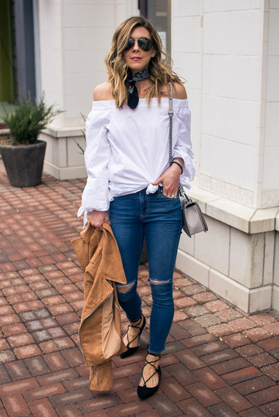 Street Style - The Top Blogger Looks Of The Week: Fashion blogger 'Cella Jane' wearing a white off the shoulder long sleeve top, distressed skinny jeans, black lace-up pointy toe flats, a black bandana, a light brown suede jacket, black aviator sunglasses and a light grey shoulder bag