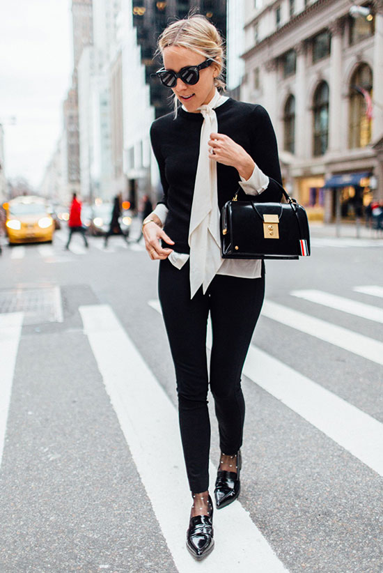 spring work outfits - 30 Spring Work Outfits To Try Right Now: Fashion Blogger 'Damsel In Dior' wearing a white tie neck blouse, a black ligth sweater, black skinny jeans, black polka dot tights, black loafers, black sunglasses and a black handbag