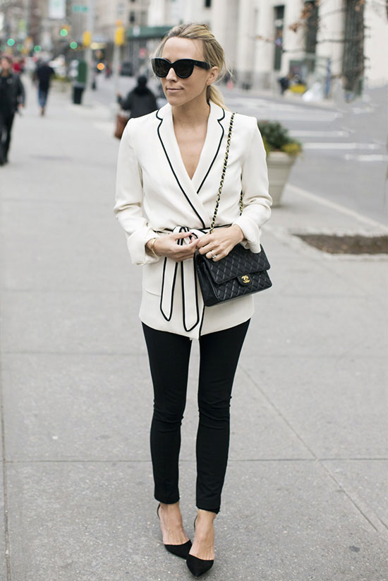 street style - The Top Blogger Looks Of The Week: Fashion blogger 'Damsel In Dior' wearing a black and white belted pajama style blouse, black skinny jeans, black suede pointy toe heels, black cat eye sunglasses and a black quilted shoulder bag. spring outfits, fall outfits, business casual, work outfits, office wear, party outfits, black and white outfits