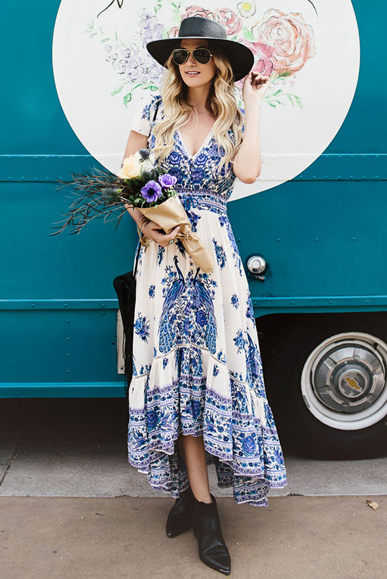 street style - The Top Blogger Looks Of The Week: Fashion Blogger 'Dash Of Darling' wearing a black hat, a blue and white boho printed maxi dress, black pointy toe booties, aviator sunglasses and a black shoulder bag - boho chic outfit - summer outfit - festival outfit - beach outfit