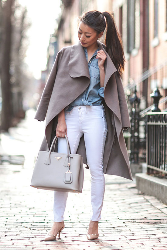 Street Style - The Top Blogger Looks Of The Week: Fashion blogger 'Extra Petite' wearing a taupe light coat, a light chambray shirt, white skinny jeans, nude pointy toe heels and a light grey handbag