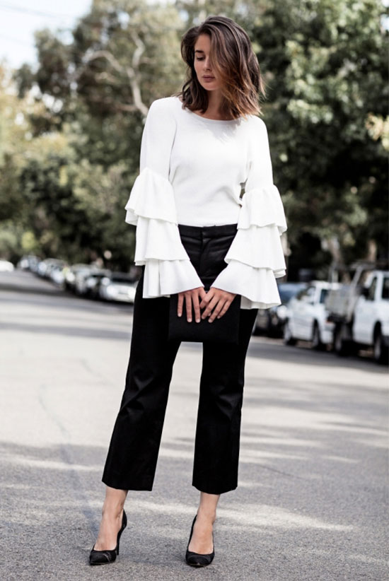 spring work outfits - 30 Spring Work Outfits To Try Right Now: Fashion Blogger 'Harper & Harley' wearing a white ruffle sleeve knit top, black ankle pants, black pointy toe heels and a black clutch