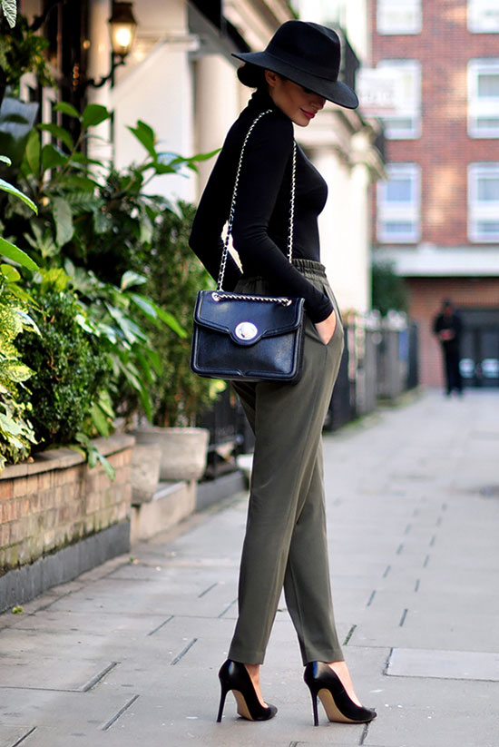 spring work outfits - 30 Spring Work Outfits To Try Right Now: Fashion Blogger 'Intrigue Me Now' wearing a black fedora, a black turtleneck body, olive ankle pants, black pointy toe heels and a black shoulder bag