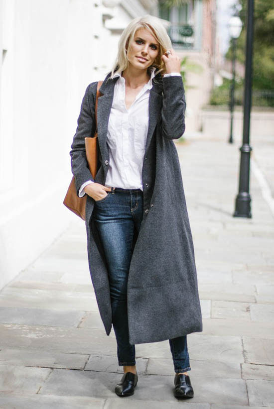 Street Style - The Top Blogger Looks Of The Week: Fashion blogger 'Like The Yogurt' wearing a long grey coat, a white shirt, dark wash skinny jeans, black loafers and a brown tote bag