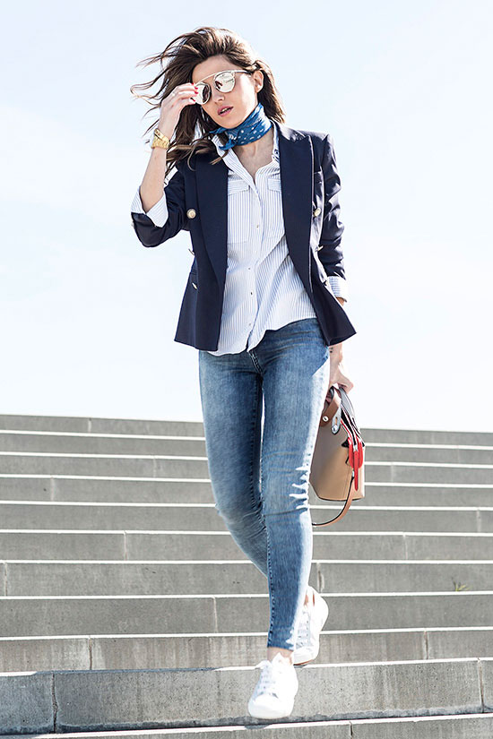 street style - The Top Blogger Looks Of The Week: Fashion Blogger 'Lovely Pepa' wearing a navy blazer, a navy bandana, a white shirt, skinny jeans, white sneakers, silver mirror sunglasses and a nude handbag