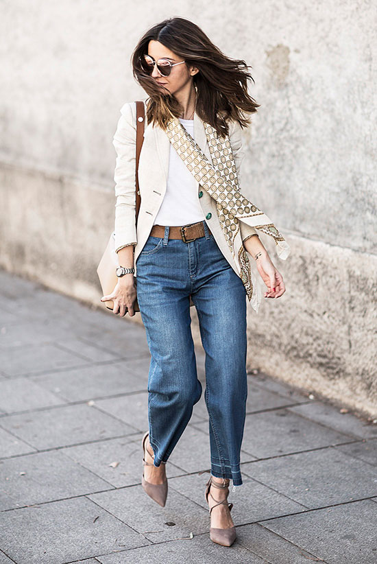 Street Style - The Top Blogger Looks Of The Week: Fashion blogger 'Lovely Pepa' wearing a beige blazer, a white round neck t-shirt, denim culottes, a brown suede belt, a gold and beige patterned silk scarf, taupe suede lace-up pointy toe heels, mirror sunglasses and a beige suede shoulder bag