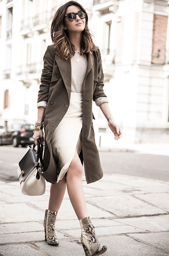 spring work outfits - 30 Spring Work Outfits To Try Right Now: Fashion Blogger 'Lovely Pepa' wearing an olive trench coat, a beige knit top, an ivory wrap pencil skirt, snake print heeled booties, black sunglasses and a color-block handbag
