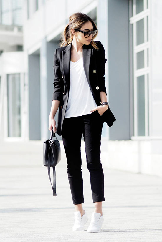 Street Style - The Top Blogger Looks Of The Week: Fashion blogger 'Lydia Elise Millen' wearing a black double breasted blazer, a white v-neck t-shirt, black ankle pants, white sneakers, black sunglasses and a black shoulder bag