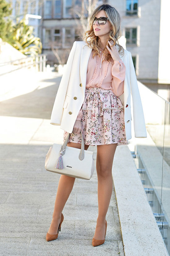 street style - The Top Blogger Looks Of The Week: Fashion Blogger 'Ma Petite by Ana' wearing a white blazer, a light pink blouse, a light pink floral print pleated mini skirt, camel suede pointy toe heels, mirror sunglasses and a white handbag