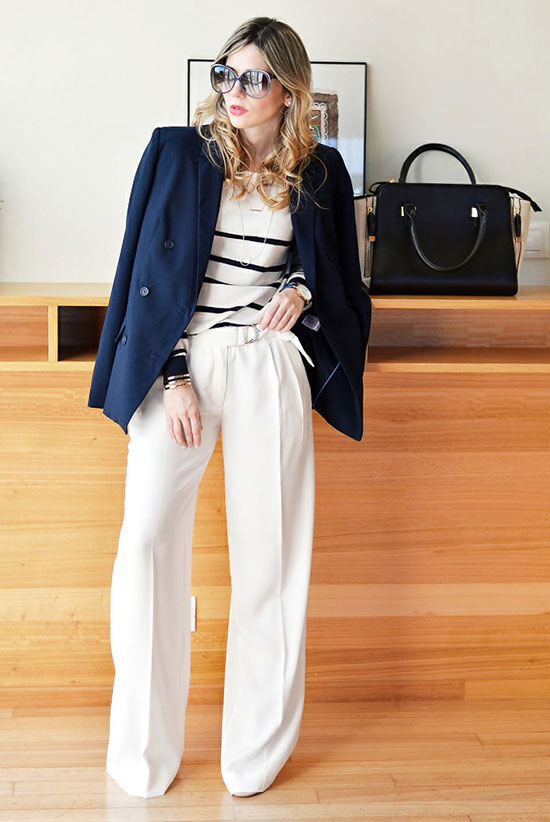 street style - The Top Blogger Looks Of The Week: Fashion blogger 'Ma Petite by Ana' wearing a navy double breasted blazer, a black and white striped sweater, white wide leg pants, nude pointy toe heels and oversized sunglasses. Spring outfits, work outfits, business casual, office wear