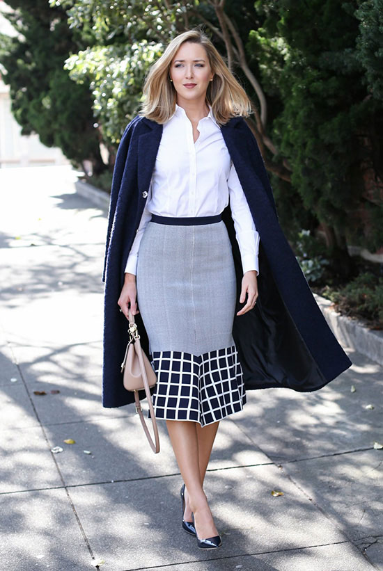 spring work outfits - 30 Spring Work Outfits To Try Right Now: Fashion Blogger 'Memorandum' wearing a navy cape, a white shirt, a navy and grey flounce pencil skirt, black pointy toe heels and a light pink shoulder bag