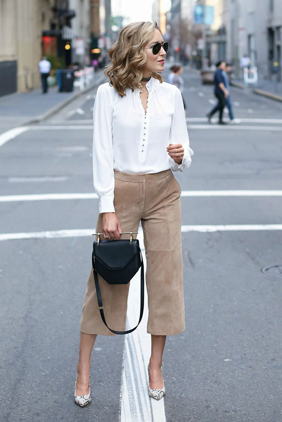 spring work outfits - 30 Spring Work Outfits To Try Right Now: Fashion Blogger 'Memorandum' wearing a white mandarin collar blouse, camel suede culottes, grey snake print pointy toe heels, black sunglasses and a black shoulder bag