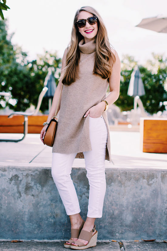 street style - The Top Blogger Looks Of The Week: Fashion Blogger 'Miss Madeline Rose' wearing a light brown turtleneck sweater tunic, white skinny jeans, light brown wedges, brown sunglasses and a brown shoulder bag - spring outfit