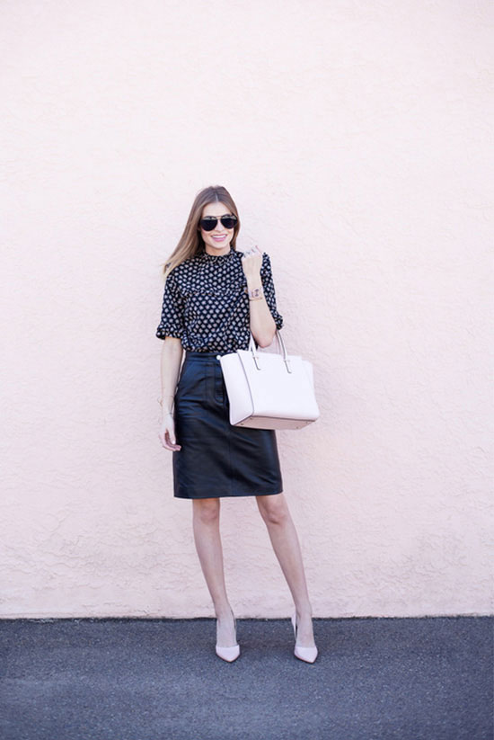 spring work outfits - 30 Spring Work Outfits To Try Right Now: Fashion Blogger 'Navy Grace' wearing a black polka dot 3/4 sleeve blouse, a leather a-line skirt, nude pointy toe heels, black sunglasses and a white handbag
