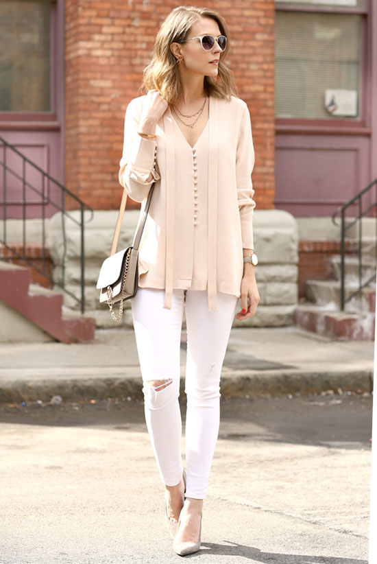 street style - The Top Blogger Looks Of The Week: Fashion Blogger 'Penny Pincher Fashion' wearing a light pink tie neck blouse, white skinny jeans, light grey suede pointy toe heels, clear sunglasses and a light grey shoulder bag - spring outfit - summer outfit