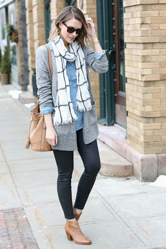 Street Style - The Top Blogger Looks Of The Week: Fashion blogger 'Penny Pincher Fashion' wearing a black and white windowpane scarf, a grey cardigan, a denim shirt, black skinny jeans, light brown western ankle boots, black sunglasses and a light brown bucket shoulder bag