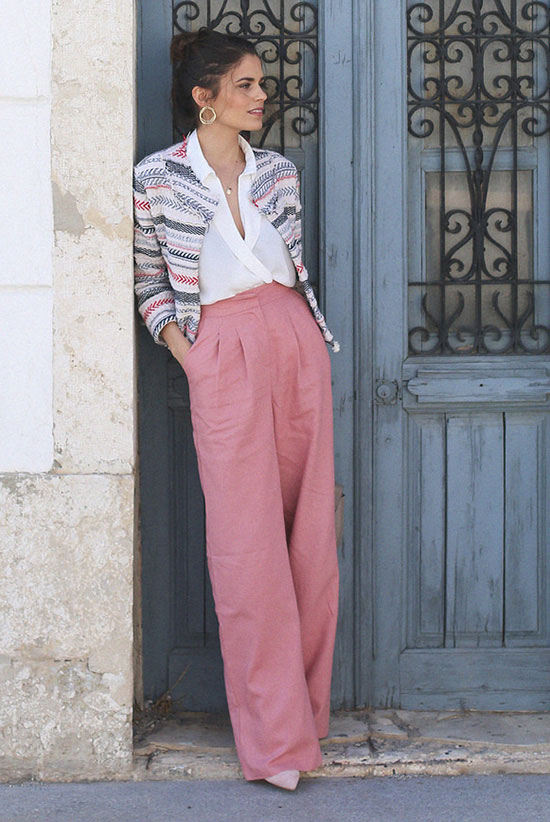 spring work outfits - 30 Spring Work Outfits To Try Right Now: Fashion Blogger 'Seams For A Desire' wearing a grey and pink stripe ethnic blazer, a white surplice blouse, pink high waist wide leg pants and light pink pointy toe pumps.