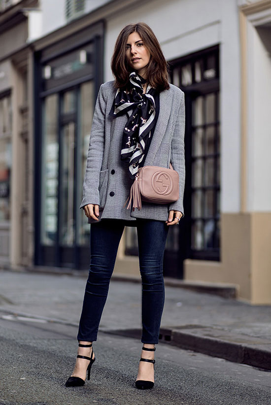 street style - The Top Blogger Looks Of The Week: Fashion blogger 'Simple Et Chic' wearing a grey blazer, a black and white silk scarf, dar denim skinny jeans, black suede pointy toe heels, a black top and a light pink tassel shoulder bag. Work outfits, office wear, fall outfits, spring outfits