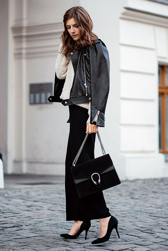 Street Style - The Top Blogger Looks Of The Week: Fashion blogger 'Simple Et Chic' wearing a black leather jacket, a cream chunky knit sweater, black culottes, black suede pointy toe heels and a black suede shoulder bag