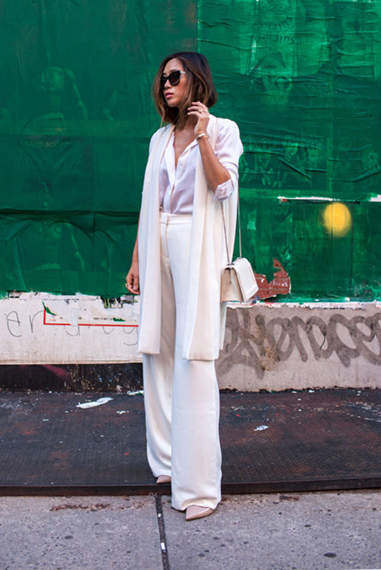 spring work outfits - 30 Spring Work Outfits To Try Right Now: Fashion Blogger 'Song Of Style' wearing a white long blazer, a white shirt, white high waist wide leg pants, nude pointy toe heels, black sunglasses and a white shoulder bag