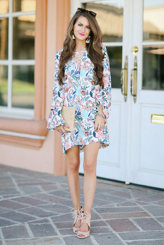 Street Style - The Top Blogger Looks Of The Week: Fashion blogger 'Southern Curls & Pearls' wearing a floral bell sleeve shift dress, nude lace up perforated wedges, brown sunglasses and a nude envelope clutch