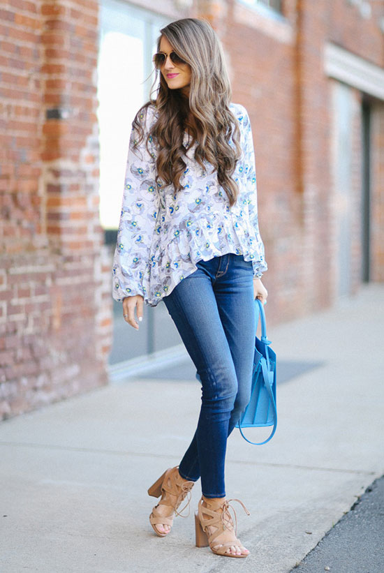 Street Style - The Top Blogger Looks Of The Week: Fashion blogger 'Souther Curls & Pearls' wearing a pale blue floral print long sleeve ruffle hem top, skinny jeans, nude lace-up bock heel sandals, a blue satchel and brown sunglasses