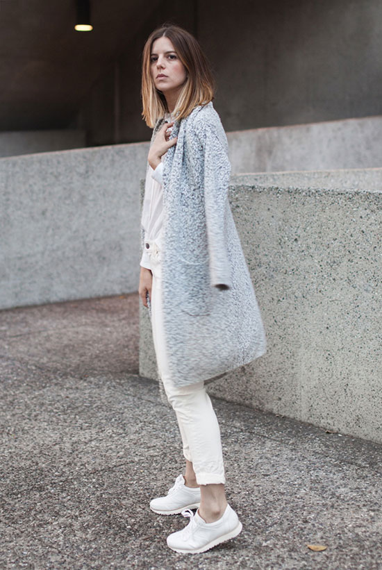 Street Style - The Top Blogger Looks Of The Week: Fashion blogger 'Take Aim' wearing a light grey long cardigan, a white shirt, white skinny jeans and white sneakers