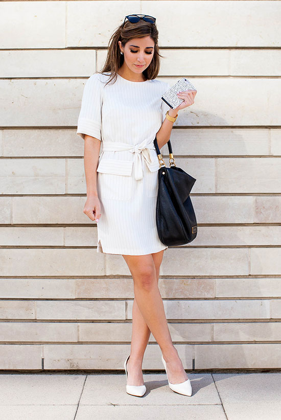spring work outfits - 30 Spring Work Outfits To Try Right Now: Fashion Blogger 'The Darling Detail' wearing a white belted short sleeve dress, white pointy toe heels, black sunglasses and a black handbag