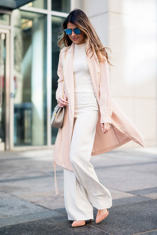 street style - The Top Blogger Looks Of The Week: Fashion blogger 'The Girl From Panama' wearing a blush duster coat, a white mock neck sweater, white wide leg pants, light pink suede pointy toe heels, mirror sunglasses and a light grey saddle bag. Spring outfits, work outfits, business casual, office wear, fall outfits