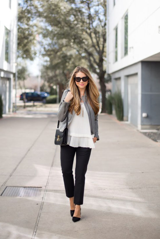 spring work outfits - 30 Spring Work Outfits To Try Right Now: Fashion Blogger 'The Teacher Diva' wearing a grey moto jacket, a white ruffle hem top, black ankle pants, black pointy toe heels, black sunglasses and a black shoulder bag