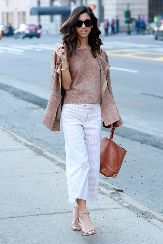 spring work outfits - 30 Spring Work Outfits To Try Right Now: Fashion Blogger 'This Time Tomorrow' wearing a light brown blazer, a light brown knit vest, white pinstripe culottes, nude heeled sandals, black sunglasses and a brown handbag
